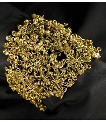Bracelet doré en fil de laiton tressé à la main par Martine Brun